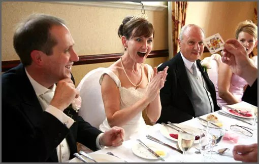 Close Up Magician performs close-up magic to applauding bride and groom