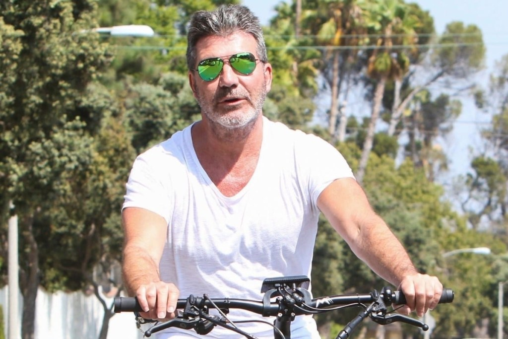 Simon Cowell riding a bike