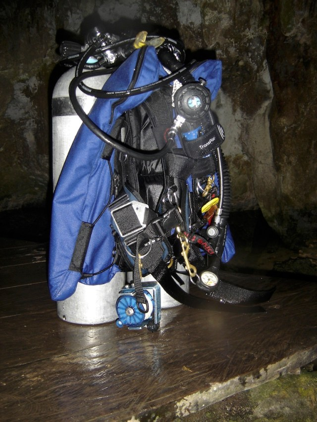 The gear necessary to cave dive using back mount tanks.