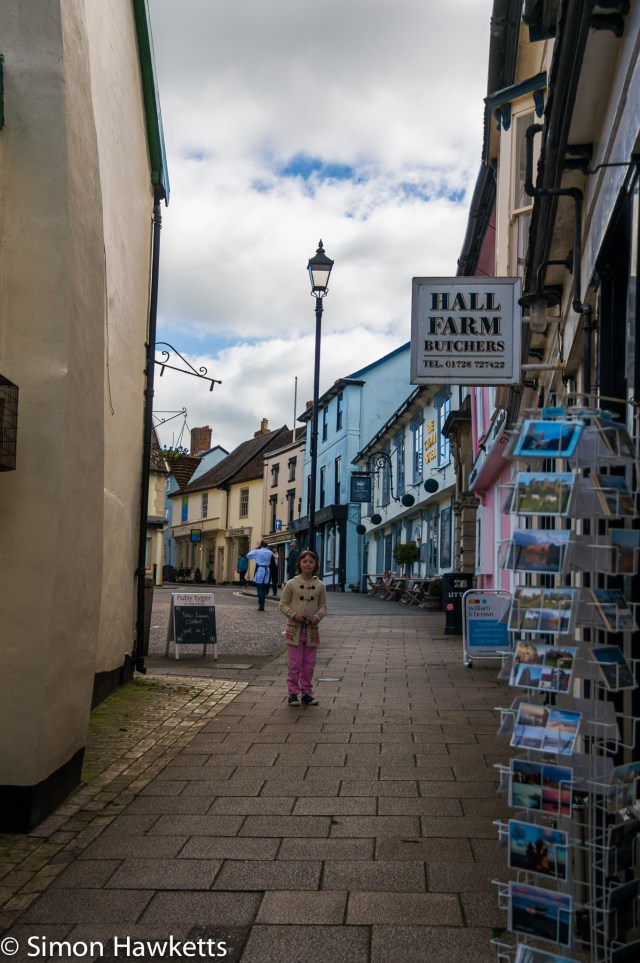 Pictures of Framlingham in Suffolk - A girl looking at postcards in a street in Framlingham