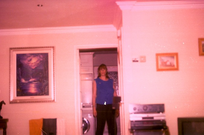 Photos from film found in old cameras - A woman standing in an interior doorway