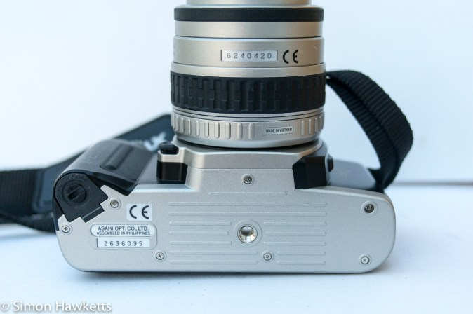 Pentax MZ-50 auto focus 35mm slr showing battery compartment and tripod mount