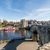 Where the City wall in York joins the bridge