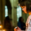 Adding another candle in York Minster