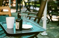 A discarded bottle of ginger beer in the tea room garden at snowshill manor