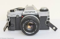 Olympus OM-20 35mm SLR - Front view with lens cap off