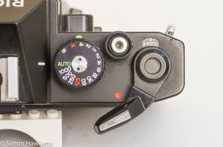 Ricoh KR-10 35mm SLR showing on/off switch integrated into film advance