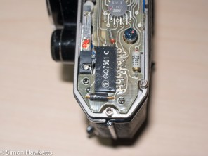 The retaining screws which retain the PCB on the spotmatic ES