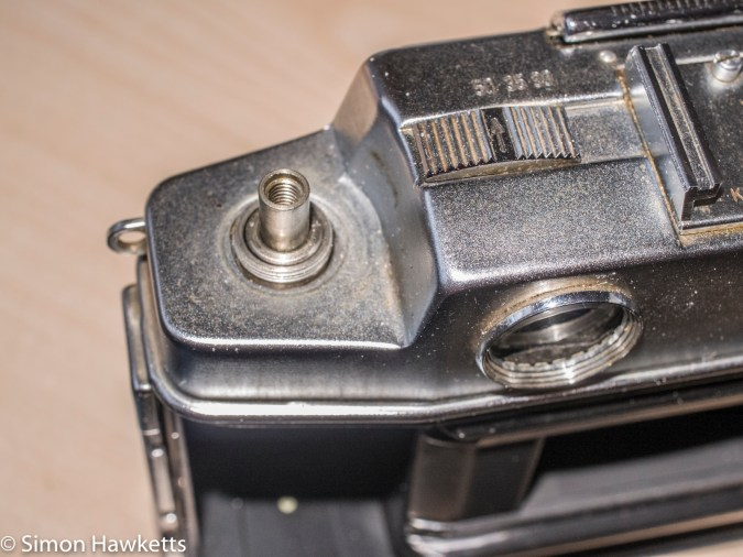 Agfa Ambi Silette 35mm rangefinder top cover removal - Lock nut removed