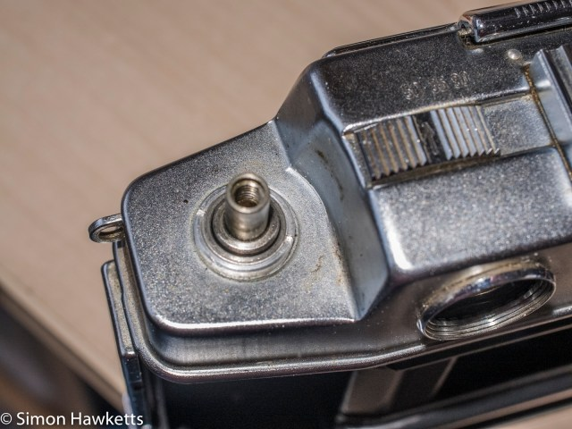 Agfa Ambi Silette 35mm rangefinder top cover removal - Rewind crank unscrewed, remove this nut