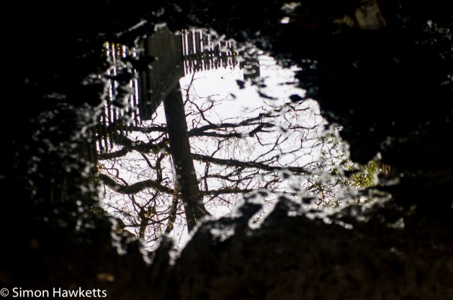 Helios 85 - 210 Auto Zoom sample picture - reflection in a puddle under the railway line