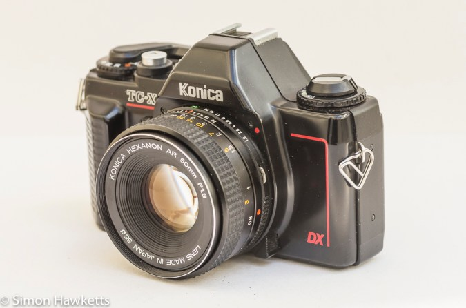 Konica TC-X DX side view showing lens release and AE lock release