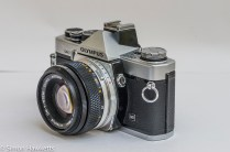 Olympus OM-2 35mm slr - side view showing flash sync socket and switch
