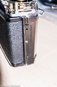 Ricoh singlex TLS strip down and repair - I removed the back by taking it off with the hinge
