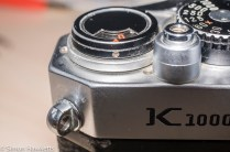 Second screw to loosen during Pentax K1000 top plate removal