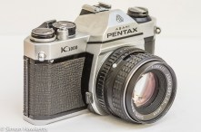Side view of the Pentax K1000 showing the lens mount release