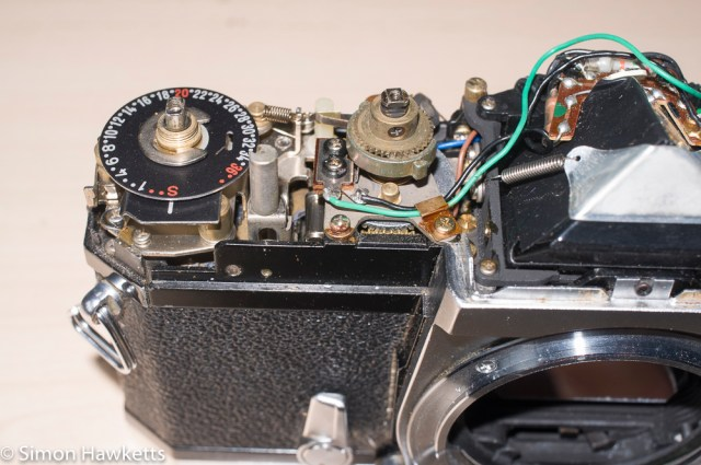 Konica Autoreflex T2 top cover removal - film advance and shutter speed under the cover