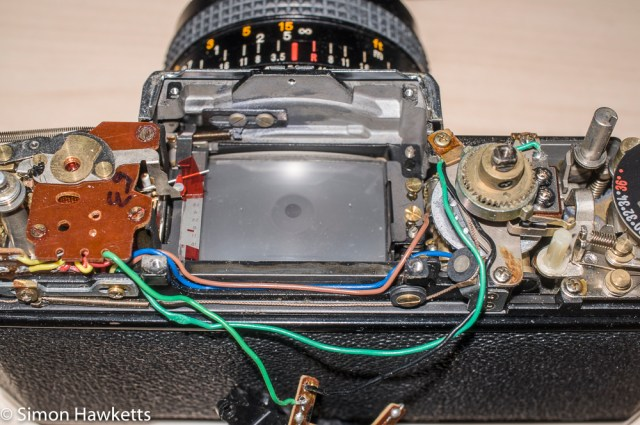 Konica Autoreflex T2 top cover removal - prism removed for cleaning