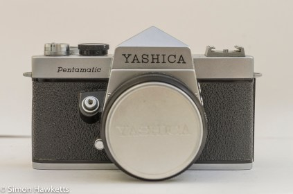 Yashica Pentamatic 35mm slr front view with lens cap on