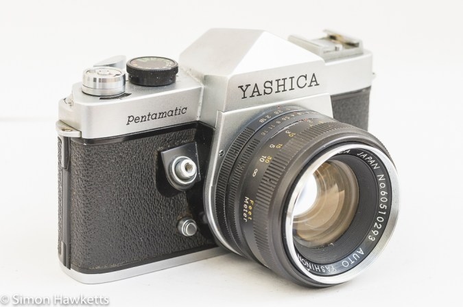 Yashica Pentamatic 35mm slr side view showing lens release and shutter button