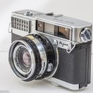 Fujica 35 SE 35mm rangefinder camera - side view showing flash sync, lens control rings and side mounted film rewind.