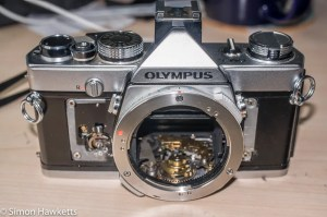 Olympus OM-1n re-assembly - Top cover fitted, just waiting for the camera covering to be replaced