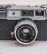Yashica J 35mm rangefinder camera front view showing Yashinon 45mm f/2.8 lens