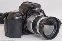 Minolta Dynax 800si autofocus 35mm camera - side view showing hand grip and AF illuminator
