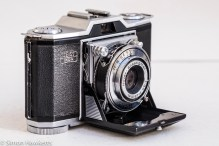 Zeiss Ikon Contina I 35mm viewfinder folding camera - side view showing shutter release