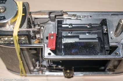Retina Reflex S re-assembly - Small jig made to hold spring