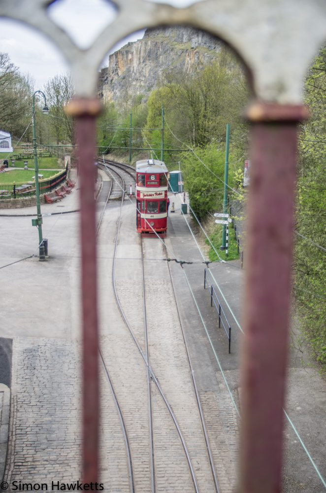 Crich tramway museum - tram viewed through railings