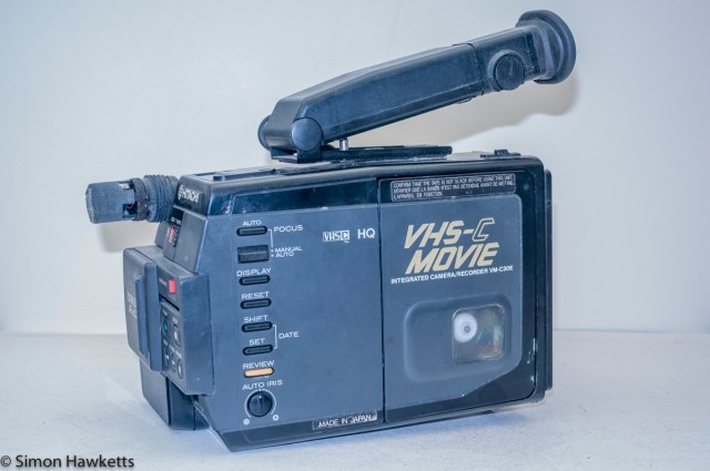Hitachi VM-C30E VHS-C camcorder - side view showing controls