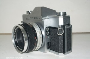 Mamiya/Sekor 500 DTL 35mm SLR camera - Side view showing metering switch and flash sync