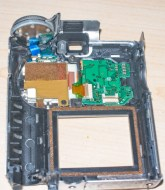 The back panel from a Fuji Finepix 4700 during a strip down procedure