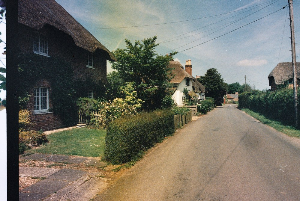 Photos from film found in old cameras - a village lane with a thatched cottage