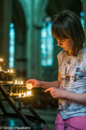 Lighting a candle in York Minster