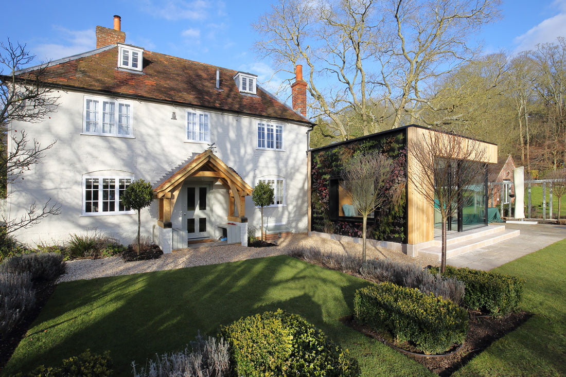 Sustainable architecture and building design, architect Oxfordshire, architect Berkshire, Architect Buckinghamshire, Architect Hampshire, local architect, contemporary architecture, house extensions, home extensions, sustainable building materials, sustainable design, architecture firm, front of house extension, porch extension, front door, green living wall, green extension, side elevation, side house extension,