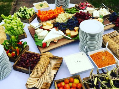 Catered appetizers include hors d'oeuvres, crackers and assorted vegetables and cheeses