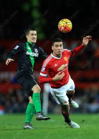 Chris Smalling of Man Utd battles with Bojan Krkic of Stoke