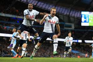 Harry Kane (R) celebrates with teammate Danny Rose after scoring Tottenham's 1st goal against Man City