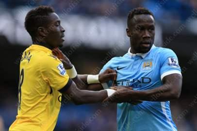 Bacary Sagna of Man City tussles with Idrissa Gueye of Villa