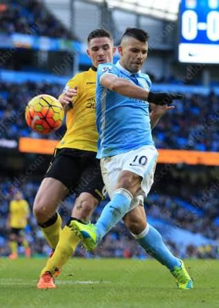 Sergio Aguero of Man City shoots past Ciaran Clark of Villa