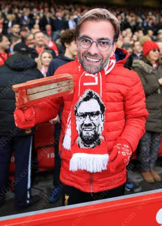 A fan of Liverpool manager Jurgen Klopp impersonates his hero
