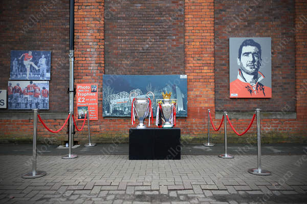 Replica versions of the UEFA Champions Leage and Barclays Premier League trophies on a stall by the roadside in Manchester