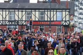 Man Utd fans make their way to the ground from The Trafford pub