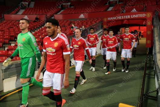 Wayne Rooney walks out to play for the Man Utd U21s
