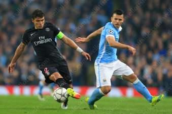 Thiago Silva of PSG battles with Sergio Aguero of Man City