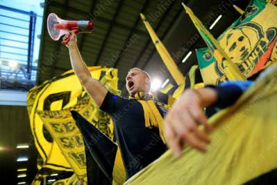 A Dortmund fan cheers his side on with the help of a megafone