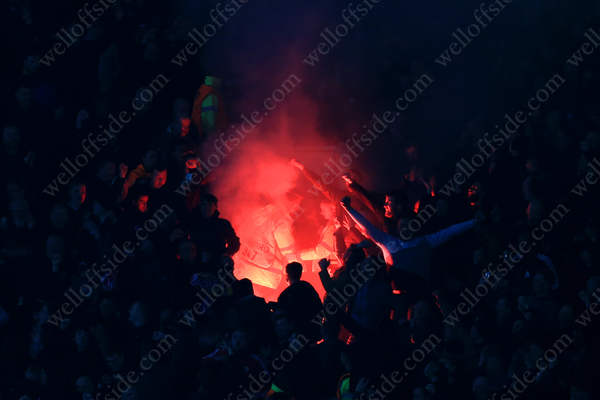 Liverpool fans set off a red flare as they celebrate their equaliser away to Man Utd in the UEFA Europa League