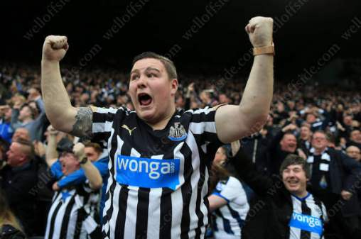 A Newcastle United fan celebrate his side's late equaliser against local rivals Sunderland